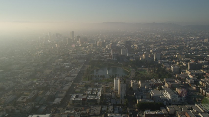 5K stock footage aerial video fly over MacArthur Park toward Koreatown, Central Los Angeles, California Aerial Stock Footage   AX0017_074E