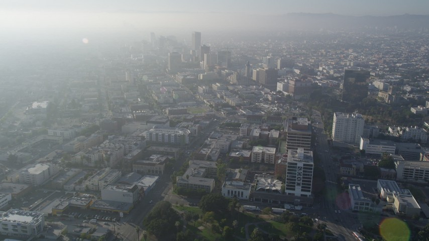 5K stock footage aerial video of flying toward Koreatown buildings and high-rises, Central Los Angeles, California Aerial Stock Footage | AX0017_075