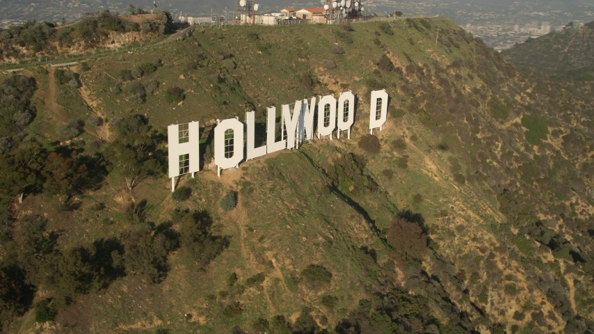5K stock footage aerial video of city sprawl and reveal Hollywood Sign, Hollywood, California Aerial Stock Footage | AX0017_090