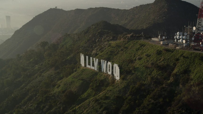 5K stock footage aerial video of orbiting the Hollywood Sign in haze, Hollywood, California Aerial Stock Footage | AX0017_093