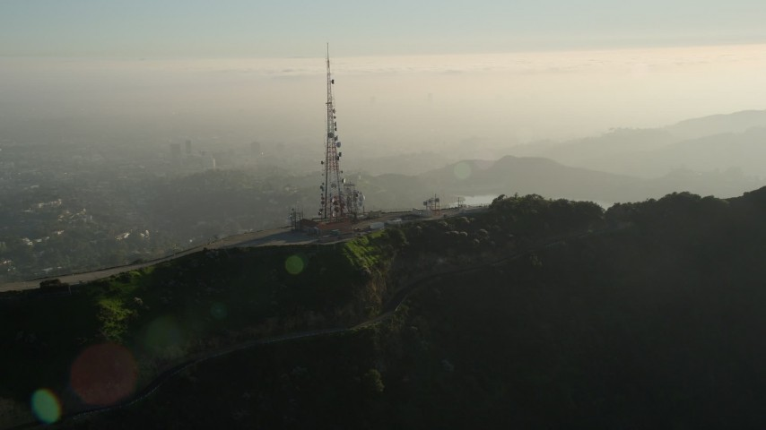 5K stock footage aerial video of orbiting a hill top radio tower, Hollywood, California Aerial Stock Footage | AX0017_094