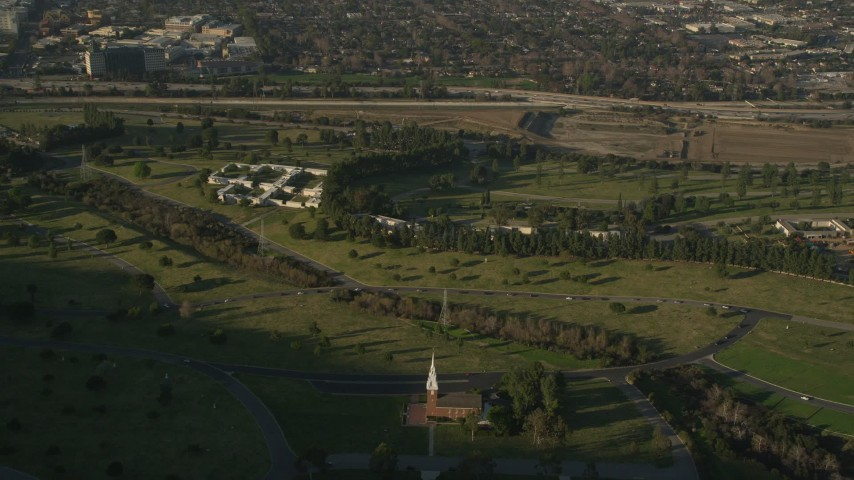 5K stock footage aerial video of flying over Forest Lawn Memorial Park, Hollywood, California Aerial Stock Footage | AX0017_097