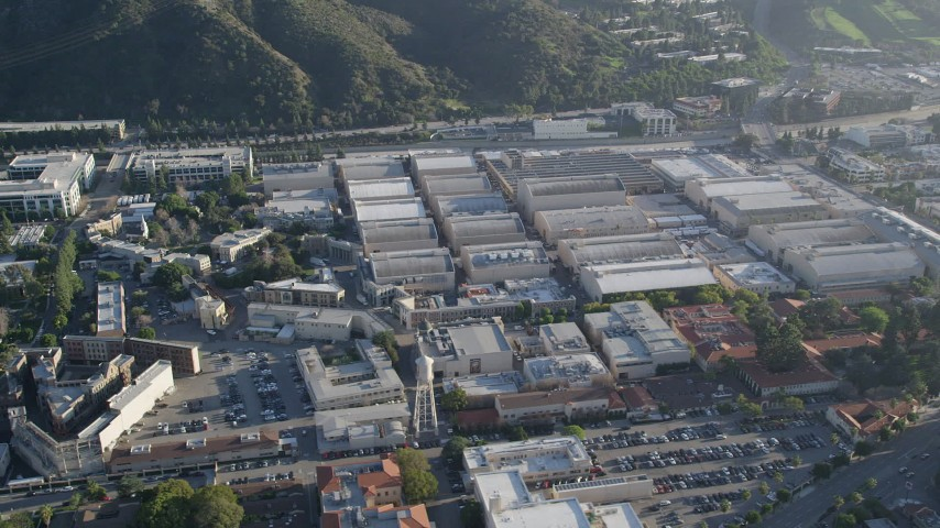 5K stock footage aerial video of orbiting Warner Brothers Studios, Burbank, California Aerial Stock Footage | AX0017_100