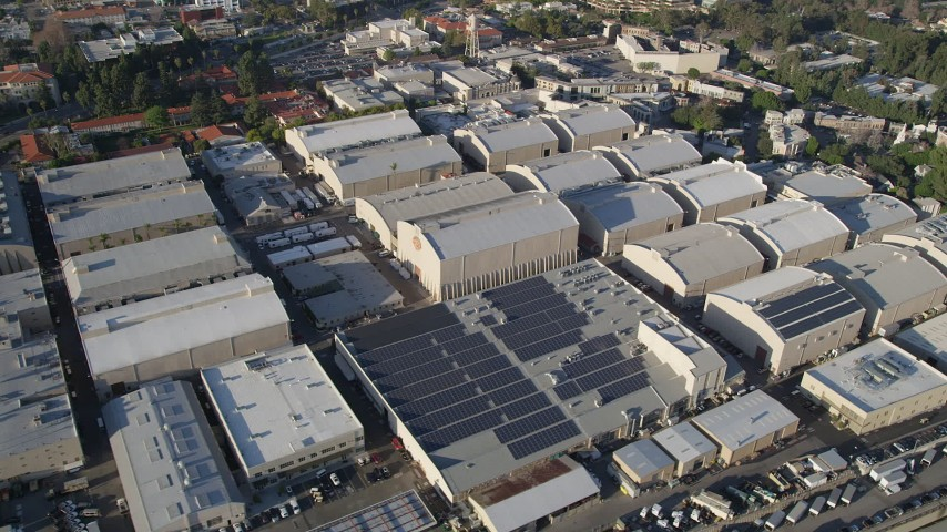 5K stock footage aerial video of circling Warner Brothers Studios, Burbank, California Aerial Stock Footage AX0017_102 | Axiom Images