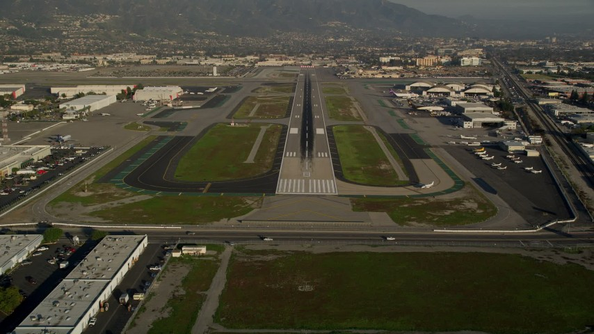 5K aerial stock footage video of approaching Bob Hope International Airport, Burbank, California Aerial Stock Footage | AX0017_111E