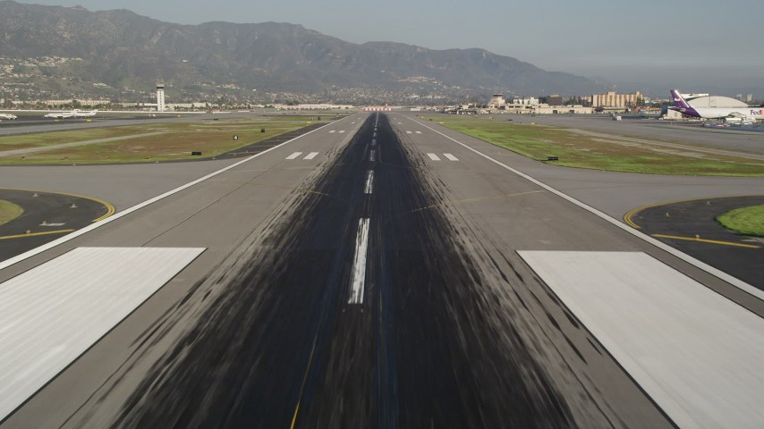 5K stock footage aerial video of approach runway at Bob Hope International Airport, Burbank, California Aerial Stock Footage | AX0017_112