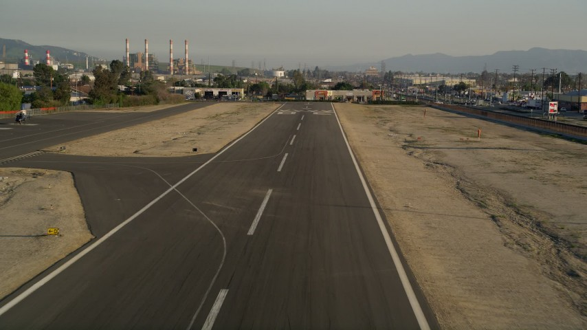 5K stock footage aerial video of runway at Whiteman Airport while landing, Pacoima, California, sunset Aerial Stock Footage | AX0017_120