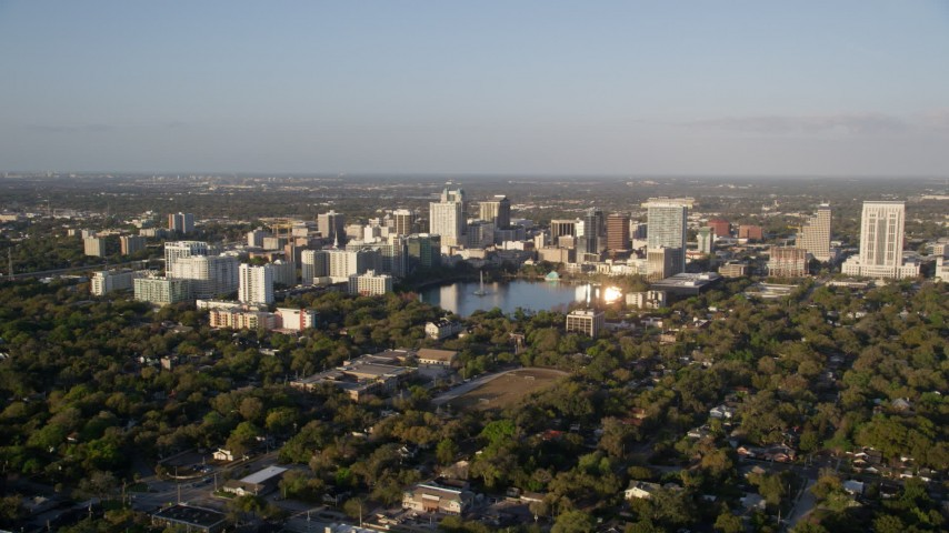 5K stock footage aerial video approach Downtown Orlando, Florida at sunrise Aerial Stock Footage | AX0018_002