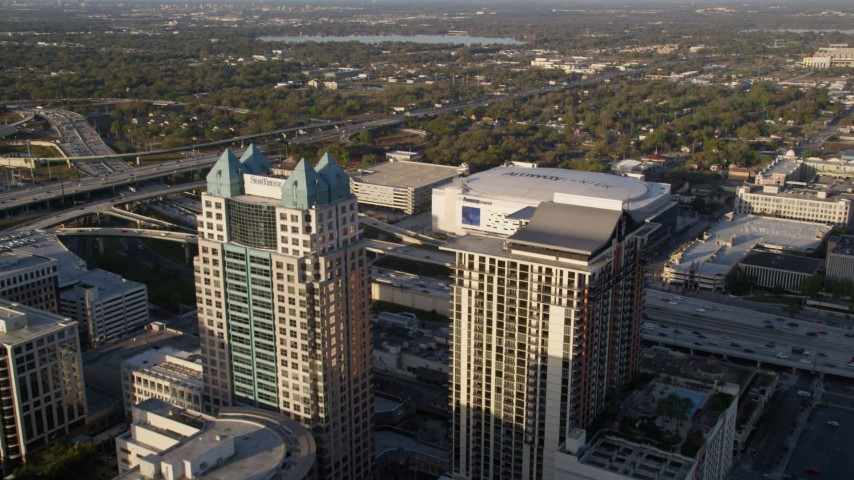 5K stock footage aerial video fly over SunTrust Center toward Amway Center in Downtown Orlando at sunrise, Florida Aerial Stock Footage | AX0018_006