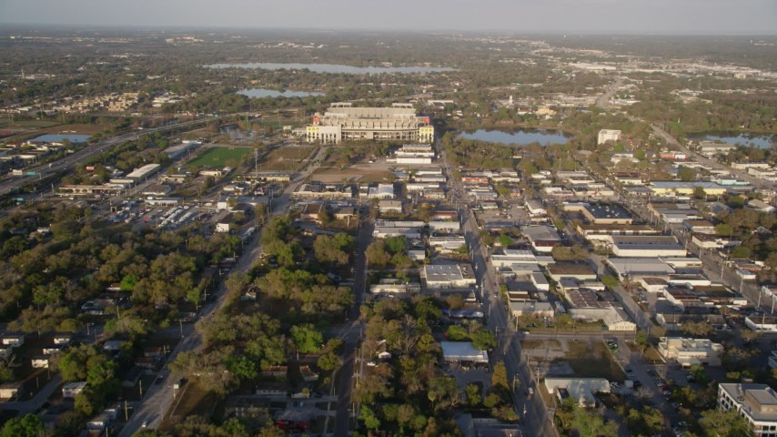 5K stock footage aerial video tilt up from neighborhood, reveal Citrus Bowl in Orlando, Florida at Sunrise Aerial Stock Footage | AX0018_008
