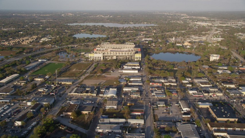 5K stock footage aerial video of approaching the Citrus Bowl beside Lake Lorna Doone at sunrise in Orlando, Florida Aerial Stock Footage | AX0018_009