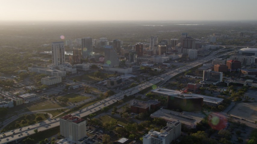 5K stock footage aerial video of Downtown Orlando and Interstate 4 at sunrise in Florida Aerial Stock Footage | AX0018_011