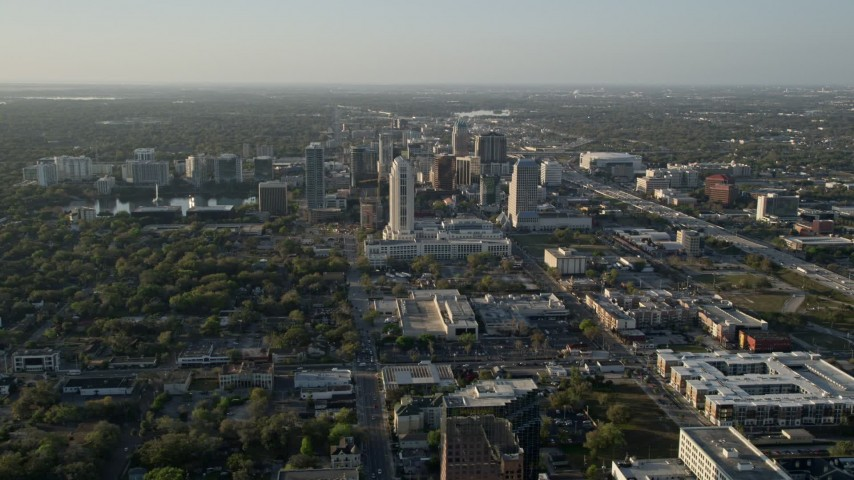 5K stock footage aerial video orbiting Downtown Orlando at sunrise in florida  Aerial Stock Footage | AX0018_013