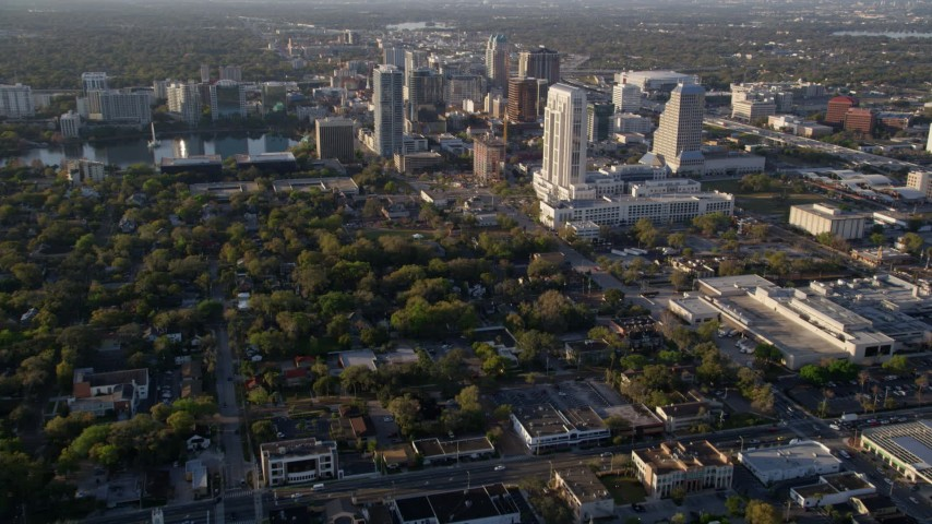 5K stock footage aerial video of approaching Downtown Orlando, Florida at sunrise Aerial Stock Footage | AX0018_014