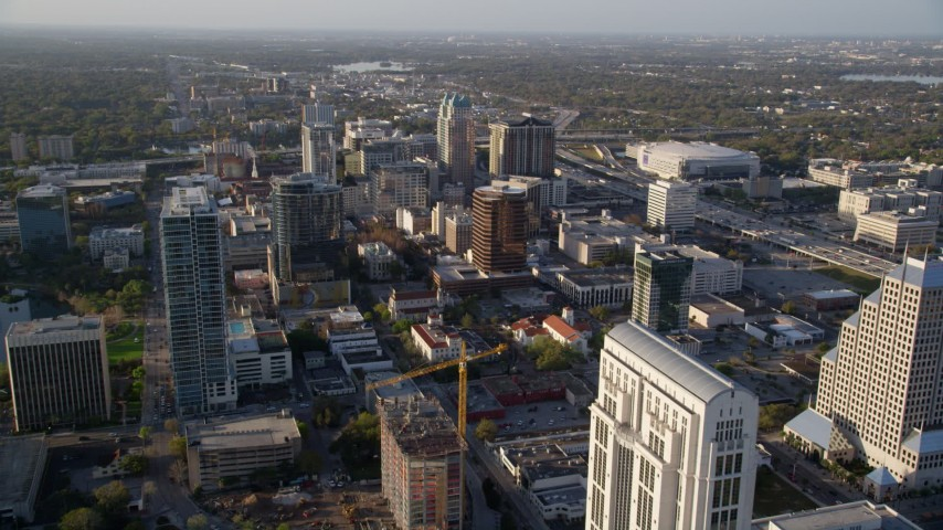 5K stock footage aerial video approach and fly over office buildings in Downtown Orlando at sunrise in Florida Aerial Stock Footage | AX0018_016