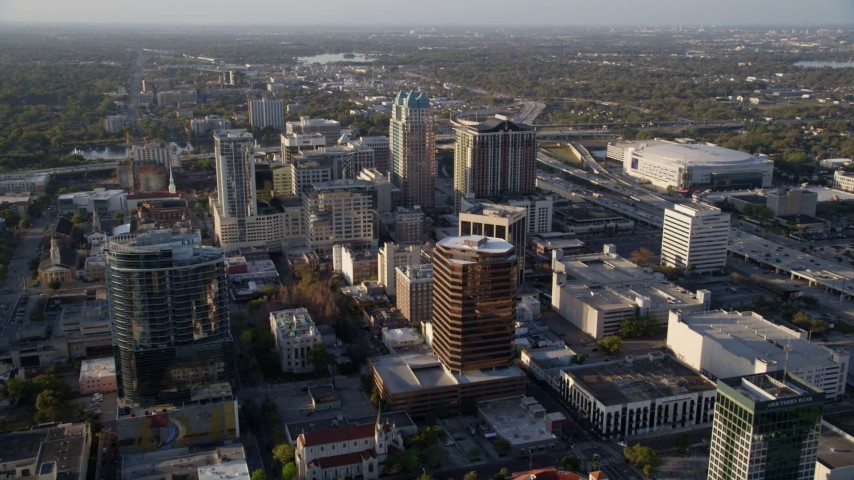 5K stock footage aerial video fly over Downtown Orlando toward office buildings at sunrise in Florida Aerial Stock Footage | AX0018_017
