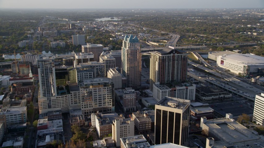 5K stock footage aerial video approach SunTrust Center in Downtown Orlando, Florida at sunrise  Aerial Stock Footage   AX0018_018