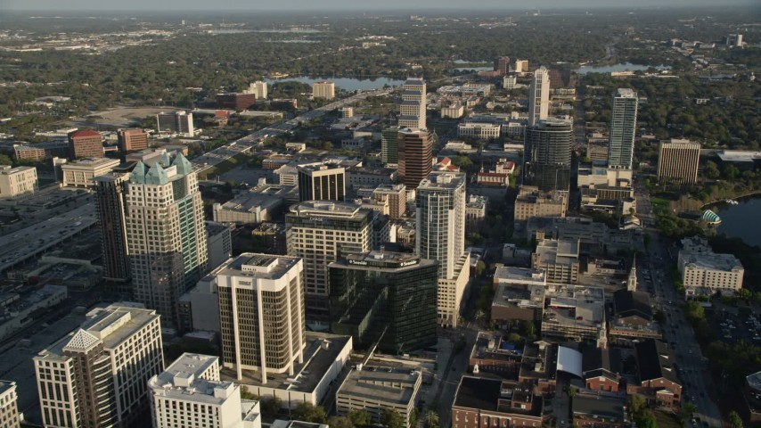 5K stock footage aerial video of office buildings in Downtown Orlando at sunrise in Florida Aerial Stock Footage | AX0018_019