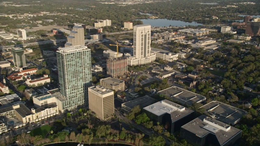 5K stock footage aerial video of office buildings in Downtown Orlando at sunrise, Florida Aerial Stock Footage | AX0018_021