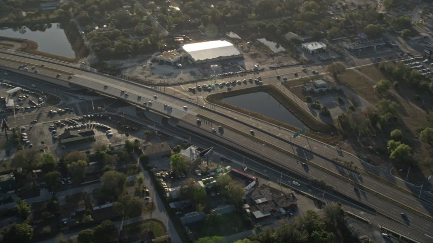 5K stock footage aerial video of light traffic on Highway 50 in Orlando at sunrise, Florida Aerial Stock Footage | AX0018_025