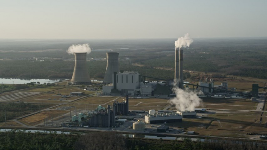5K stock footage aerial video approach Stanton Energy Center power plant in Orlando at sunrise, Florida Aerial Stock Footage   AX0018_027