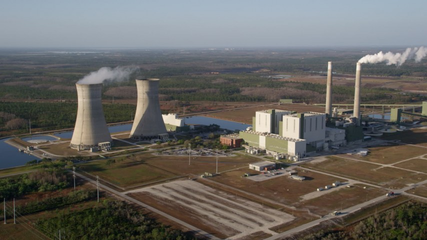 5K stock footage aerial video of Stanton Energy Center power plant in Orlando at sunrise in Florida Aerial Stock Footage | AX0018_028