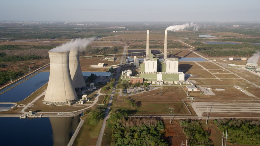 5K stock footage aerial video of the Stanton Energy Center power plant in Orlando, Florida at sunrise Aerial Stock Footage AX0018_030 | Axiom Images