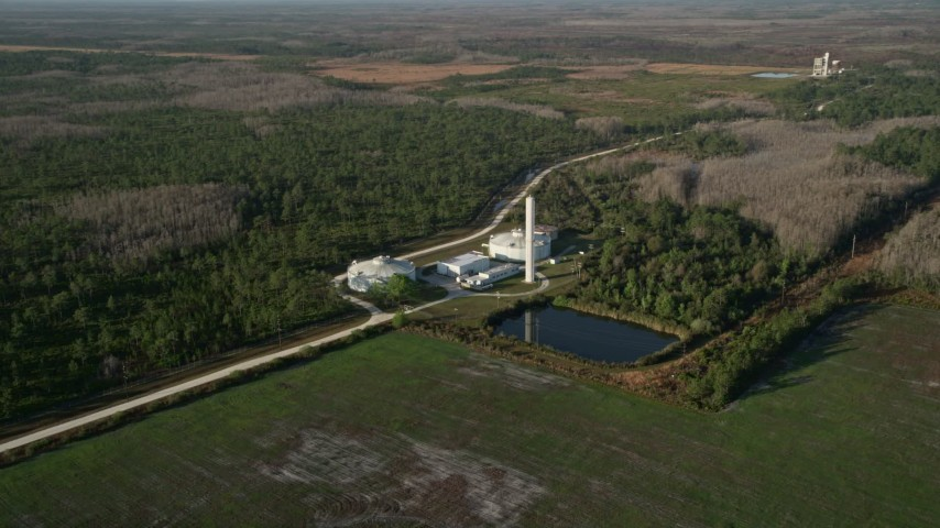 5K stock footage aerial video of large water tanks at an Orlando farm at sunrise, Florida Aerial Stock Footage | AX0018_032
