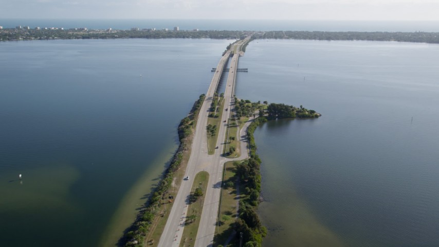 5K stock footage aerial video fly over light traffic on Melbourne Causeway spanning Indian River, Florida Aerial Stock Footage | AX0018_065