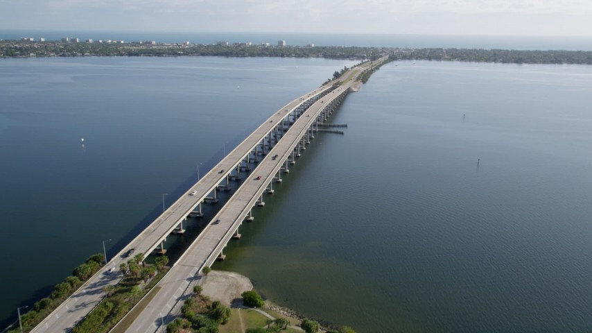 5K stock footage aerial video of light traffic on the Melbourne Causeway over the Indian River in Florida Aerial Stock Footage | AX0018_066