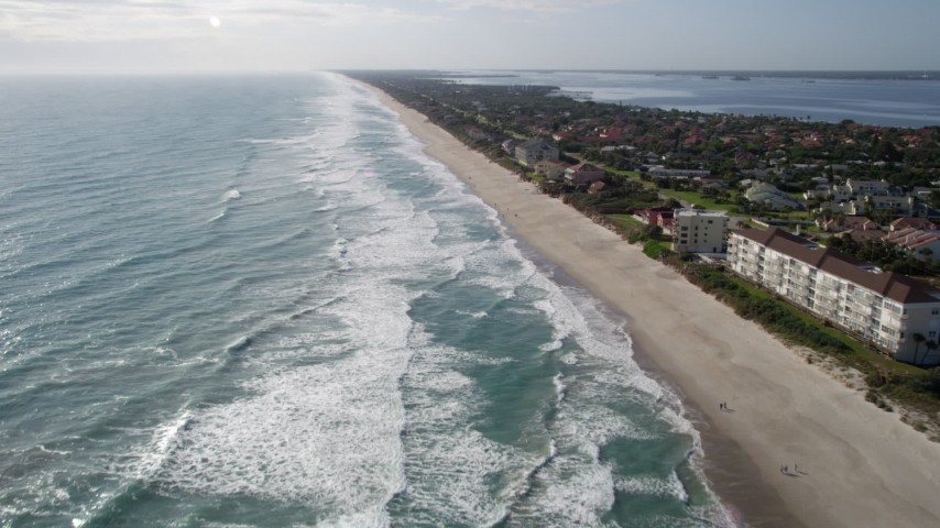 5K stock footage aerial video fly over waves on Melbourne Beach in Florida Aerial Stock Footage | AX0018_069