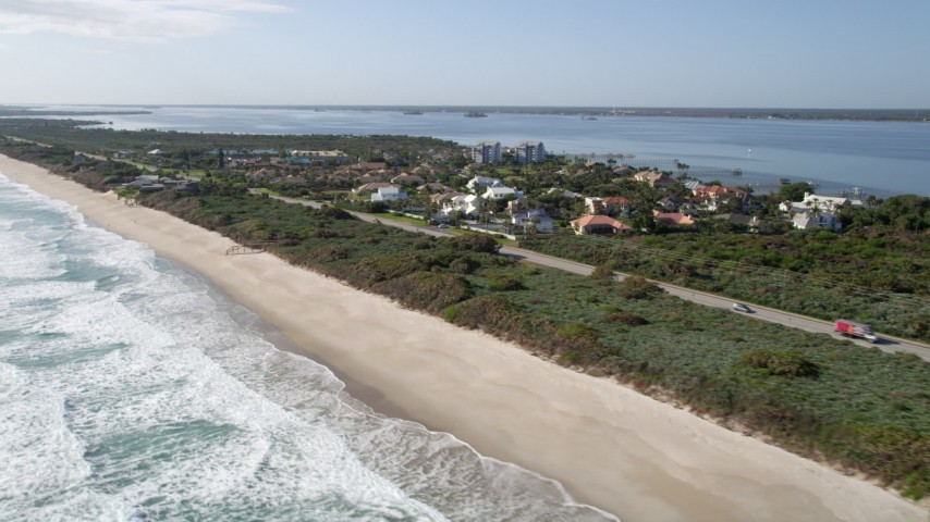 5K stock footage aerial video flyby beachfront homes in Melbourne Beach, Florida Aerial Stock Footage | AX0018_072
