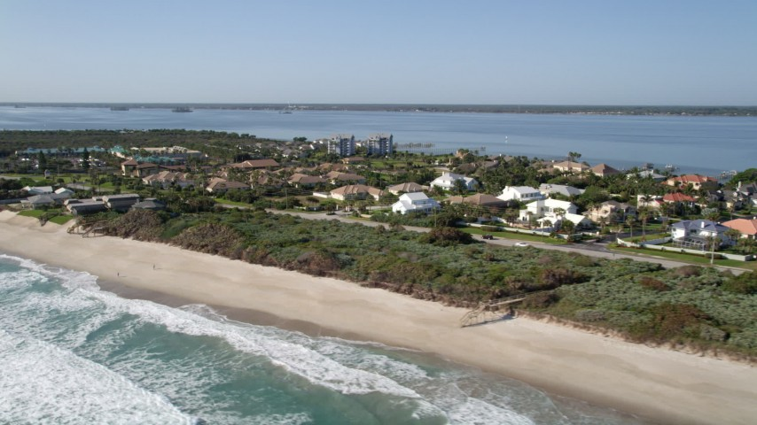 5K stock footage aerial video of a small beachfront neighborhood in Melbourne Beach, Florida Aerial Stock Footage | AX0018_073