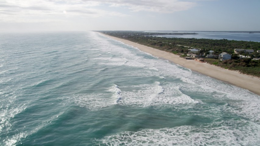 5K stock footage aerial video fly over ocean waves by Melbourne Beach, Florida Aerial Stock Footage | AX0018_076