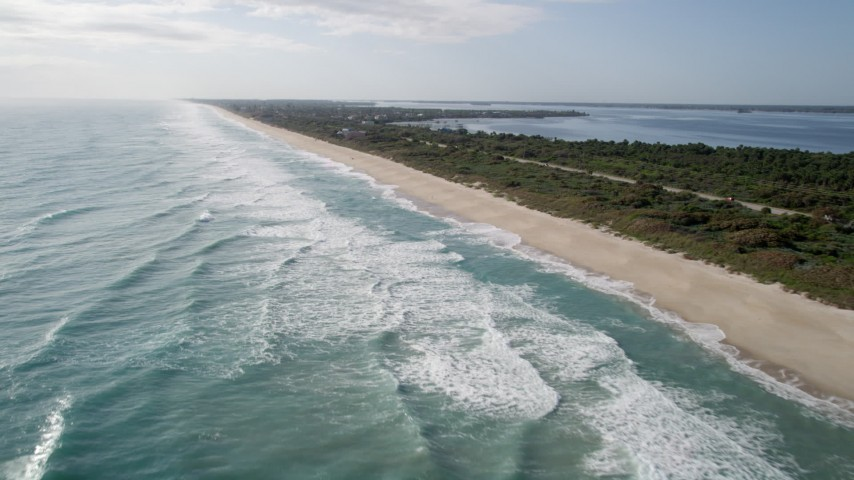 5K stock footage aerial video flyby the shore of Melbourne Beach in Florida Aerial Stock Footage | AX0018_077