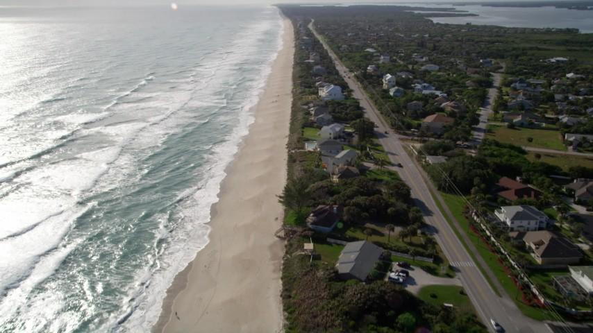 5K stock footage aerial video fly over homes on the beach in Melbourne Beach, Florida Aerial Stock Footage | AX0018_081