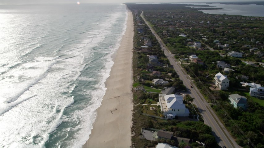 5K stock footage aerial video fly over Melbourne Beach homes by the beach and ocean in Florida Aerial Stock Footage | AX0018_082
