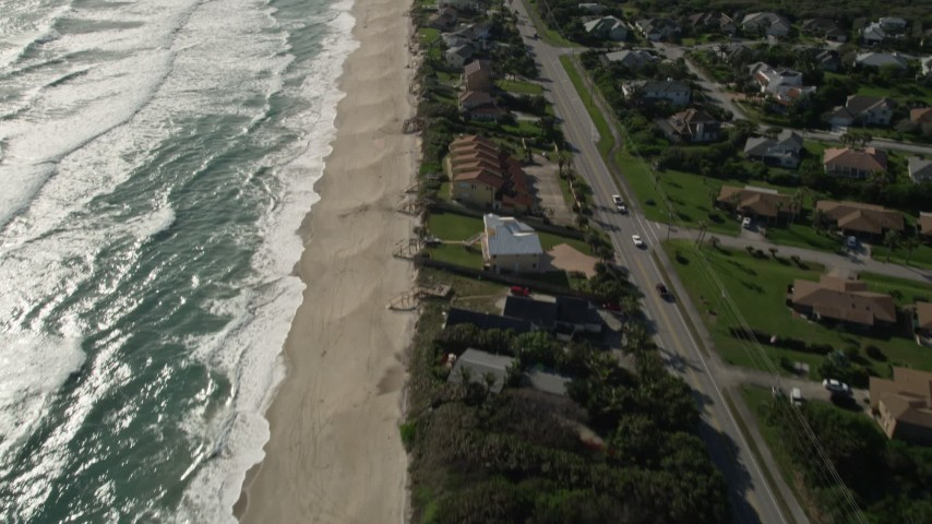 5K stock footage aerial video fly over beachfront homes in Melbourne Beach, Florida Aerial Stock Footage | AX0018_083