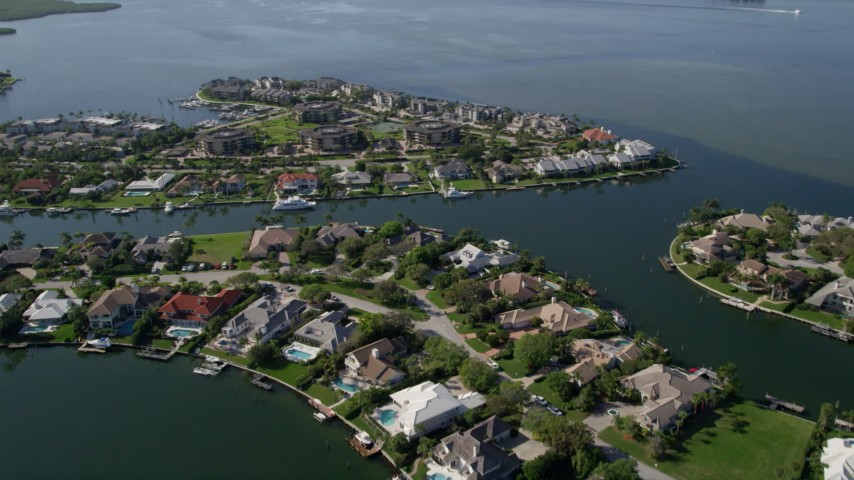 5K stock footage aerial video fly over waterfront homes on the Indian River in Melbourne Beach, Florida Aerial Stock Footage | AX0018_084