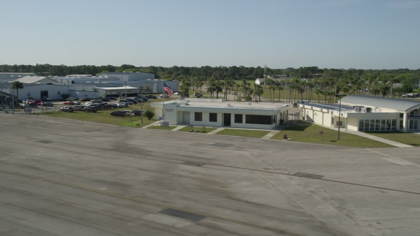 5K stock footage aerial video of approaching the office at St. Lucie County International Airport in Florida Aerial Stock Footage | AX0018_102