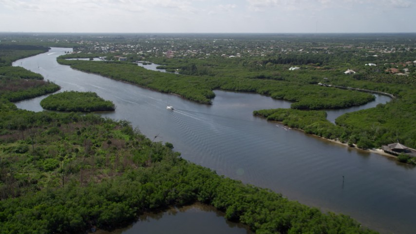 5K stock footage aerial video approach the Indian River through Hobe Sound, Florida Aerial Stock Footage | AX0019_008