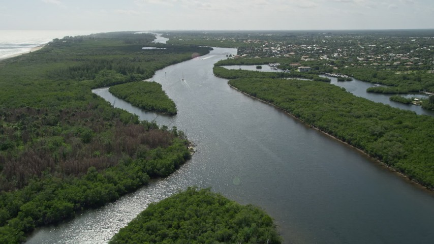 5K stock footage aerial video approach and fly over boats on the Indian River through Hobe Sound, Florida Aerial Stock Footage | AX0019_008E