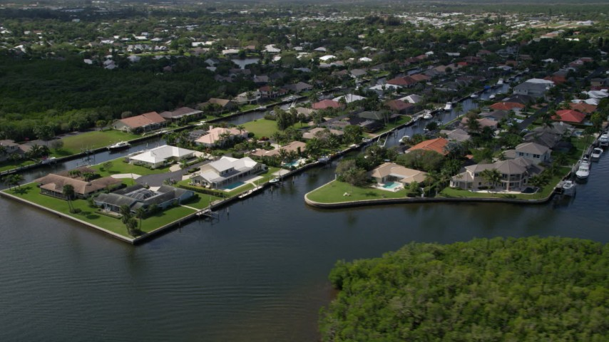 5K stock footage aerial video pass waterfront neighborhoods on canals by the Indian River in Hobe Sound, Florida Aerial Stock Footage | AX0019_014