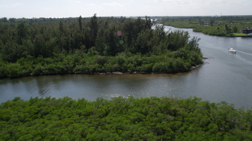 5K stock footage aerial video approach and fly over mangroves lining the Indian River in Hobe Sound, Florida Aerial Stock Footage | AX0019_015