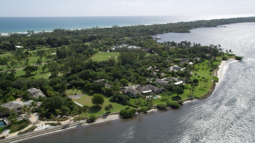 5K stock footage aerial video of waterfront mansions in Hobe Sound, Florida Aerial Stock Footage | AX0019_020