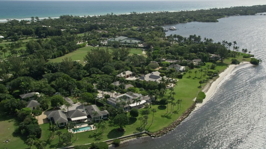 5K stock footage aerial video of waterfront mansions in Hobe Sound, Florida Aerial Stock Footage | AX0019_020E
