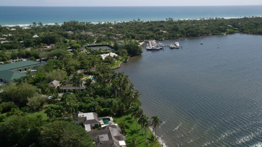 5K stock footage aerial video of mansions on the Indian River in Hobe Sound, Florida Aerial Stock Footage | AX0019_021