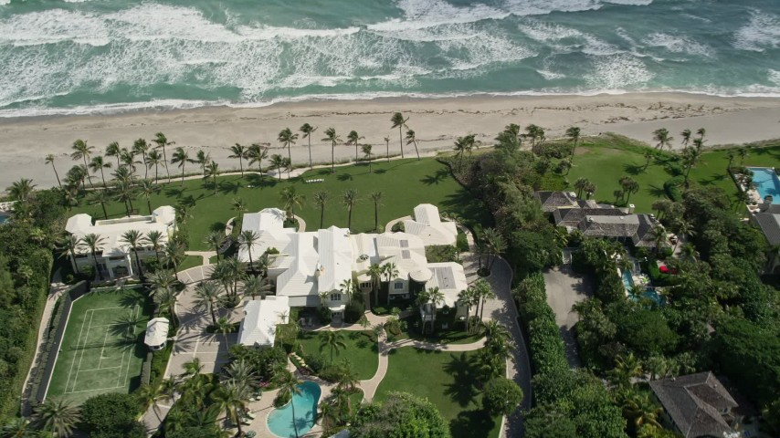 5K stock footage aerial video of a beachfront mansion in Hobe Sound, Florida Aerial Stock Footage | AX0019_025