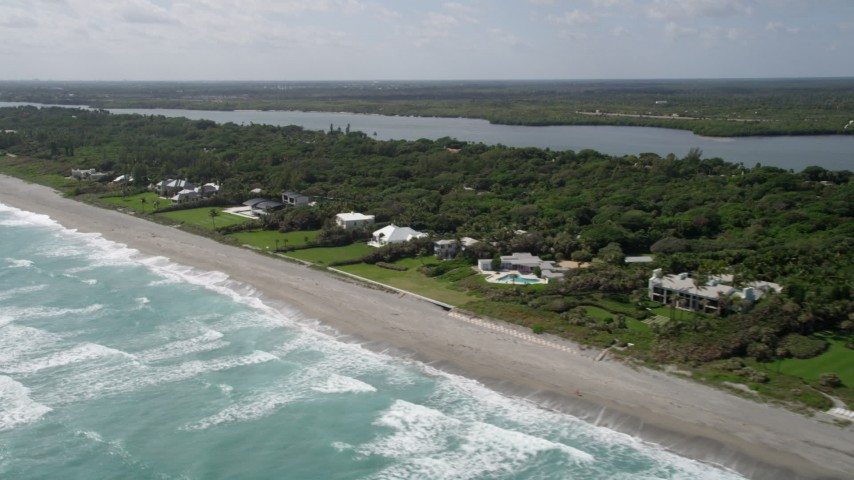5K stock footage aerial video of a row of beachfront mansions in Hobe Sound, Florida Aerial Stock Footage | AX0019_027