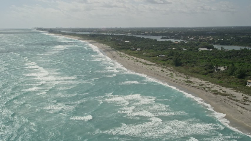 5K stock footage aerial video of beach near homes in Hobe Sound, Florida Aerial Stock Footage | AX0019_030